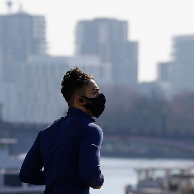 jogger-in-a-mask-runs-along-westminster-bridge-in-a-quiet-news-photo-1586189447.jpg